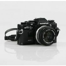 Olympus OM10  black with Zuiko 50mm 1.8 lens and quartz date back