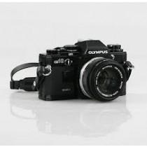 Olympus OM10  black with Zuiko 50mm 1.8 lens and quartz date back